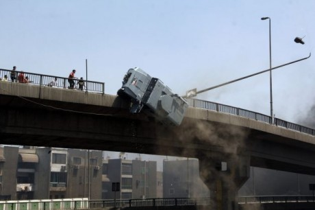 Police vehicle pushed off Oct 6 Bridge, Cairo, Wed., Aug 14.  Photo: Aly Hazzaa, El Shorouk Newspaper