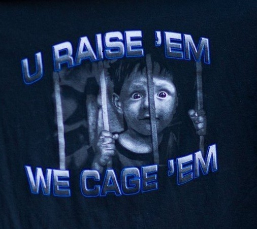 police raise cage kids