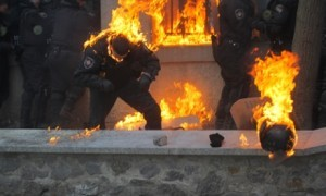 "Ukraine Riot Police Set Ablaze by Rioters in Kiev - source ""The Guardian"""
