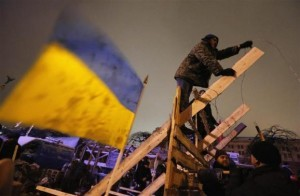 Pro-European integration protestors build new barricades in Independence Square in Kiev
