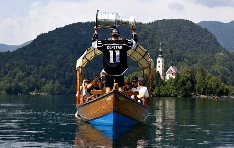JESENICE, SLOVENIA, FRIDAY, JULY 6, 2012 ññ Kings center Anze Kopitar raises the Stanley Cup as he floats across Lake Bled, Slovenia, with family and friends.